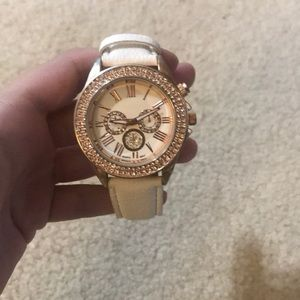 Gold face white band watch
